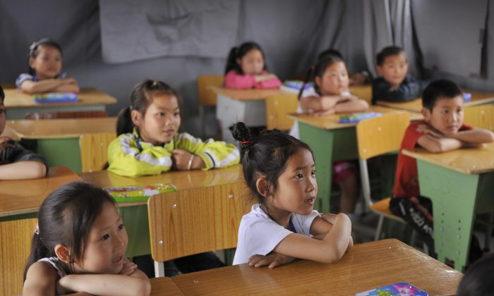 Children listen to their teacher in a classroom in the town of Mianyang, Sichuan Province, China, on May 22, 2008. (PETER PARKS/AFP/Getty Images)