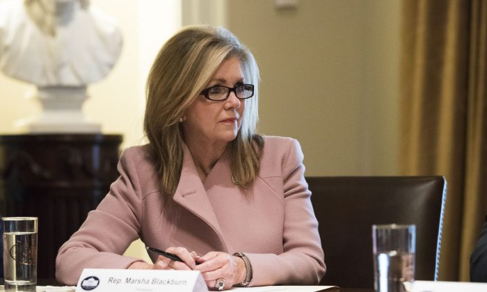 Rep. Marsha Blackburn (R-Tenn.) meets with President Donald Trump and bipartisan members of Congress to discuss school and community safety in the Cabinet Room of the White House, on Feb. 28, 2018. (Samira Bouaou/The Epoch Times)