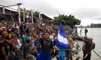 Migrant Caravan Tears Down Fence at Guatemala Border