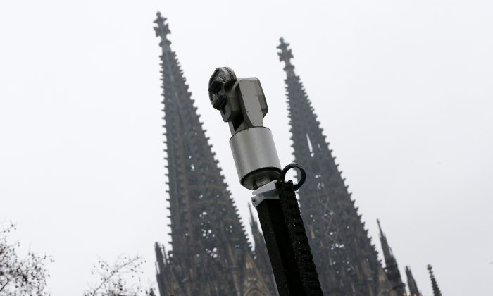 Mobile police surveillance cameras in front of the steeples of Cologne Cathedral in this file photo. (Reuters/Wolfgang Rattay/File Photo)