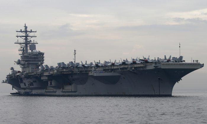 U.S. aircraft carrier USS Ronald Reagan anchors off Manila Bay for a goodwill visit in Manila, Philippines, on June 26, 2018. (Bullit Marquez/AP)