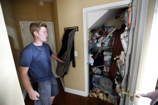 Mike Maddox, quarterback for the Mosley High football team, shows the closet in which he hid