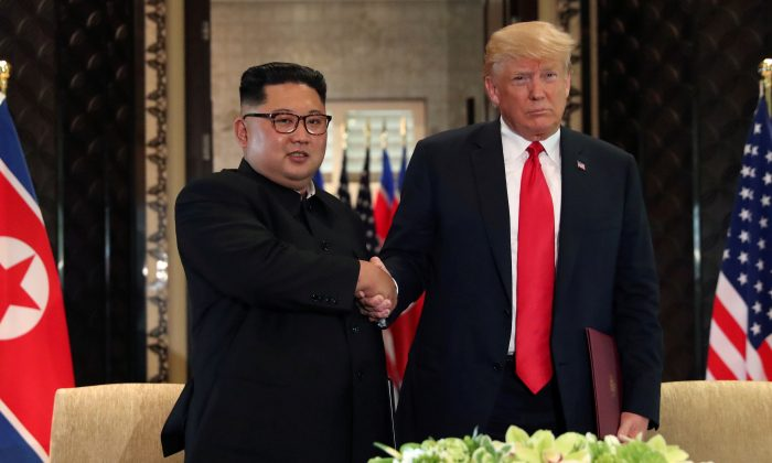President Donald Trump shakes hands with North Korea's leader Kim Jong Un after they signed documents that acknowledged the progress of the talks and pledge to keep momentum going, after their summit at the Capella Hotel on Sentosa island in Singapore June 12, 2018. REUTERS/Jonathan Ernst/File Photo