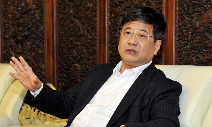 Zheng Xiaosong, head of China's liaison office to Macau, speaks at a meeting in Fuzhou City, Fujian Province, China, on April 23, 2016. (Reuters/Stringer)