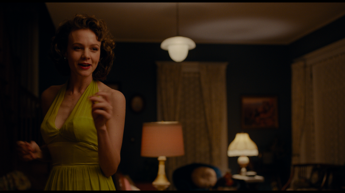 Jeanette Brinson Carey Mulligan in a green dress