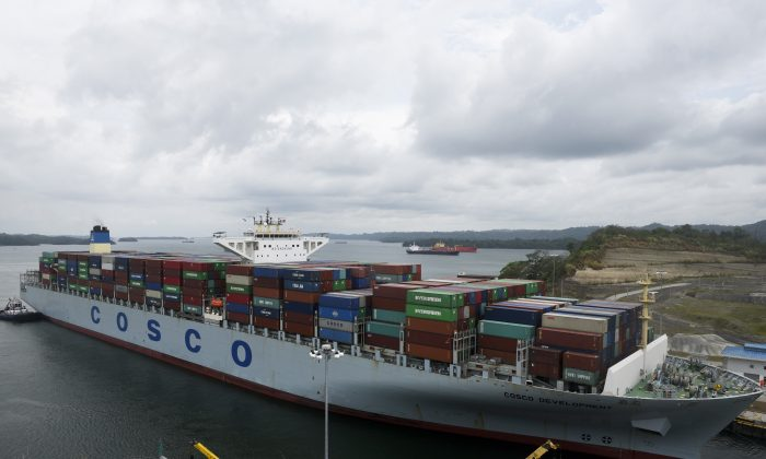 A container ship belonging to Cosco, China's state-owned shipping company, is seen near Panama City on May 2, 2017. (Rodgrio Arangua/AFP/Getty Images)