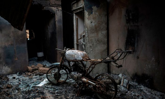 File photo showing a burnt out motorcycle in a house burned down amidst violent clashes between farmers and Fulani herders over land use and resources, Ganaropp, Nigeria, June 27, 2018. (Stefan Heunis/AFP/Getty Images)