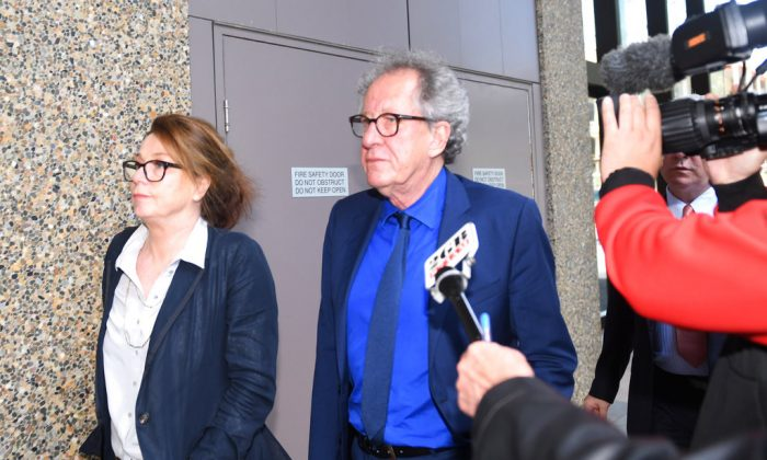 Australian actor Geoffrey Rush, center, leaves the Federal Court in Sydney, Australia, on Oct. 22, 2018. (Dean Lewins/AAP Image via AP)