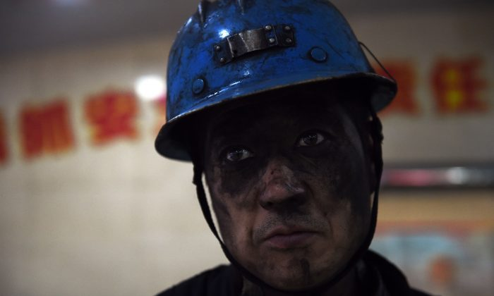A miner is seen after his shift at a coal mine in China. (GREG BAKER/AFP/Getty Images)