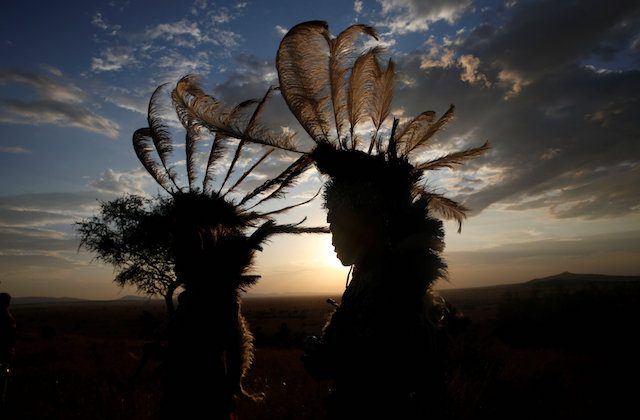 Dancers from the Kurya community are seen before performing in front of visitors to the Singita Grumeti Game Reserve, Tanzania, Oct. 7, 2018. (Reuters/Baz Ratner)