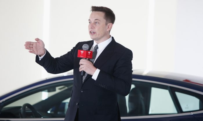 Elon Musk, Chairman, CEO and Product Architect of Tesla Motors, addresses a press conference to declare that the Tesla Motors releases v7.0 System in China on a limited basis for its Model S, which will enable self-driving features such as Autosteer for a select group of beta testers in Beijing, China, on Oct. 23, 2015. (VCG/Getty Images)