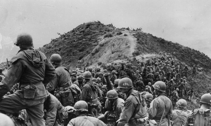 Men of the 187th U.S. Regimental Combat Team prepare to take a ridge position somewhere in Korea on May 3, 1951.  (Keystone/Getty Images)