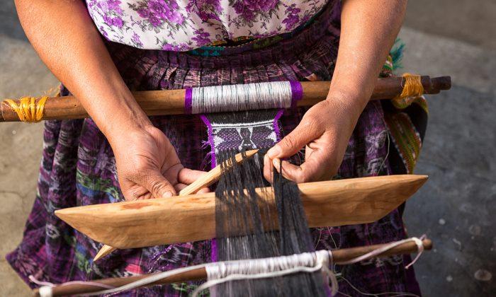 Maya woman making a traditional belt. (Shutterstock)