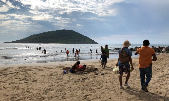 Tourists enjoy the beach in Mazatlan, Sinaloa state, Mexico, on Oct. 21, 2018. Hurricane Willa is expected to land, on Oct. 23. (Daniel Slim/AFP/Getty Images)