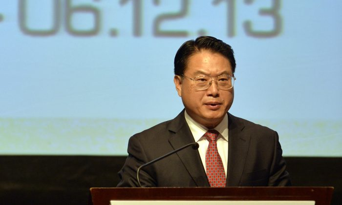 Li Yong, director general of the U.N. Industrial Development Organization (UNIDO), participates in a UNIDO event in Lima, Peru, on Dec. 2, 2013. (Cris Bouroncle/AFP/Getty Images)