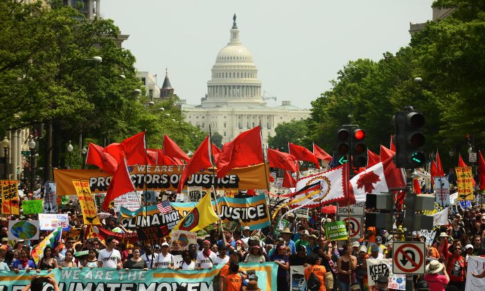 People march to protest President Donald Trump's environmental policies in Washington on April 29, 2017. Many environmentalists don't accept dissenting opinions and employ fascist tactics to reach their goals.  (Astrid Riecken/Getty Images)