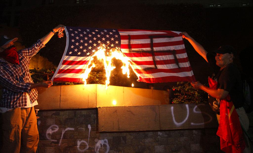Hondurans burn American flag outside embassy