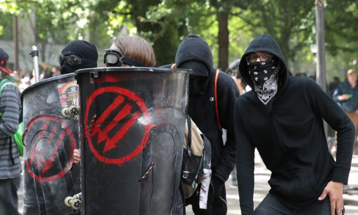Police clash with 'Antifa' members and anti-Trump protesters during a protest on June 4, 2017 in Portland, Oregon. Leftists always resort to violence to achieve their objective after all other means have been exhausted. Scott Olson/Getty Images