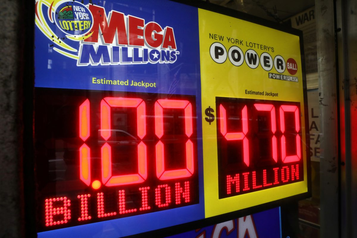 signs displaying the jackpots for Mega Millions and Powerball lottery