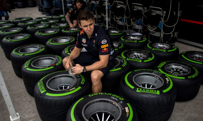 A staff member at the Formula One Chinese Grand Prix working with Pirelli tires, in Shanghai on April 6, 2017. (JOHANNES EISELE/AFP/Getty Images)