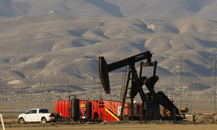 A natural gas pump jack is pictured in Lost Hills, California on March 24, 2014. (David McNew/Getty Images)