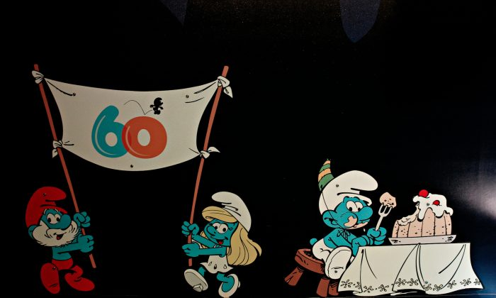 Smurf characters displayed at the Smurf Experience exhibition in Brussels, Belgium, marking the 60th anniversary of the creation of the Smurfs by cartoonist Peyo, on June 21, 2018. (Alexandros Michailidis/Shuterstock)