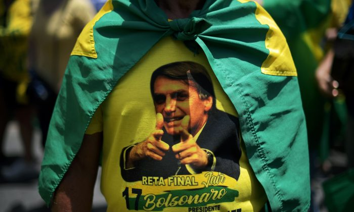 Supporters of Brazil's presidential conservative candidate Jair Bolsonaro take part in a rally in Copacabana, Rio de Janeiro, on Oct. 21, 2018. Barring any last-minute upset, Brazil appears poised to elect Bolsonaro as its next president. (CARL DE SOUZA/AFP/Getty Images)