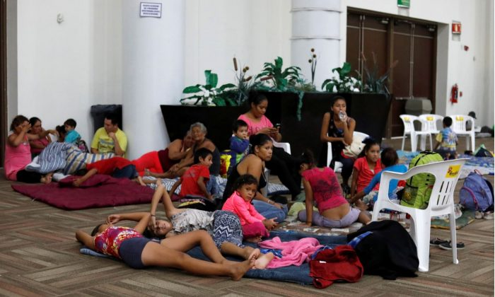 People who were evacuated from their homes are seen in a big room at the Convention Center being used as a shelter while Hurricane Willa approaches the Pacific beach resort, Mexico Oct. 23, 2018. (Reuters/Henry Romero)
