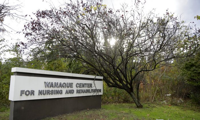 A general look of the marquee outside of the Wanaque Center For Nursing And Rehabilitation, where New Jersey state Health Department confirmed the 18 cases of adenovirus, Oct. 23, 2018, in Haskell, N.J. (AP Photo/Julio Cortez)