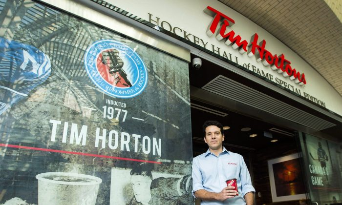 Alex Macedo, president at Tim Hortons poses for a photograph at the Hockey Hall of Fame Tim Hortons location in Toronto on Aug. 16, 2018. (The Canadian Press/Nathan Denette)