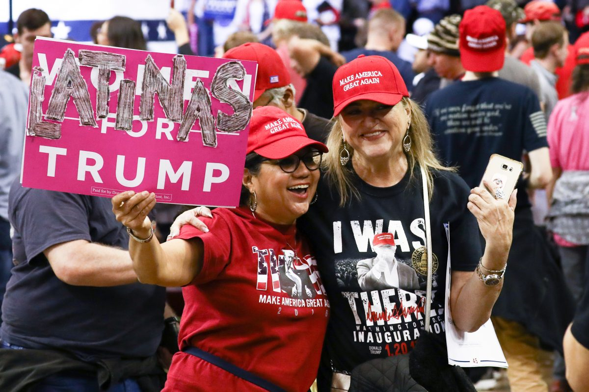Trump supporters wear MAGA hats