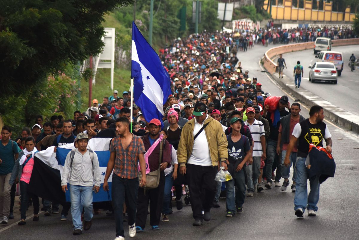 Hondurans and others in a migrant caravan move toward the United States