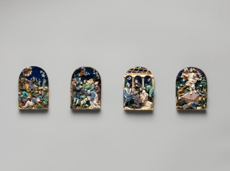 Set of four enamelled silver plaquettes