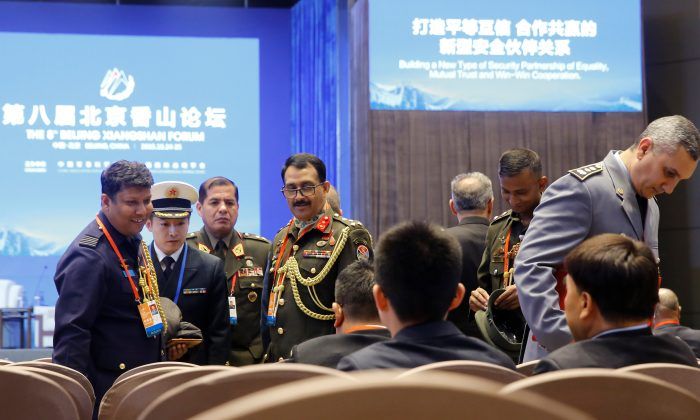 Military delegates attend the Xiangshan Forum in Beijing on Oct. 25, 2018. (Thomas Peter/Reuters)