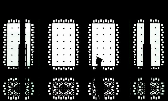 A Chinese soldier stands guard at the main entrance door of the Bayi building in Beijing on April 23, 2013. (Andy Wong-Pool/Getty Images)