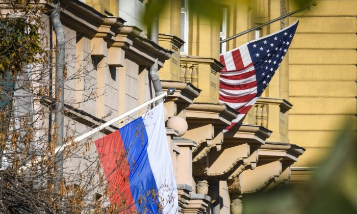 A Russian flag flies next to the U.S. embassy building in Moscow on Oct. 22, 2018. U.S. national security adviser John Bolton is in Moscow holding meetings with senior Russian officials following Washington's weekend announcement of withdrawal from the Cold War-era Intermediate-Range Nuclear Forces Treaty, known as the INF. (MLADEN ANTONOV/AFP/Getty Images)