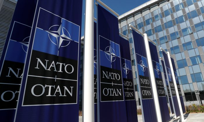 Banners displaying the NATO logo are placed at the entrance of new NATO headquarters during the move to the new building, in Brussels, Belgium, on April 19, 2018. (Yves Herman/Reuters)