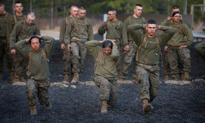 Marines participate in a combat conditioning exercise during Marine Combat Training on at Camp Lejeune, North Carolina, on Feb. 20, 2013. (Scott Olson/Getty Images)