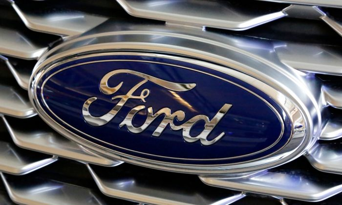 A Ford logo on the grill of a car on display at the Pittsburgh Auto Show on Feb. 15, 2018. (Gene J. Puskar/AP)