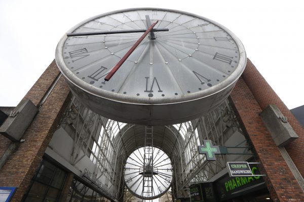 A ladder is put in place for a technician to service a huge clock in Cergy, France.