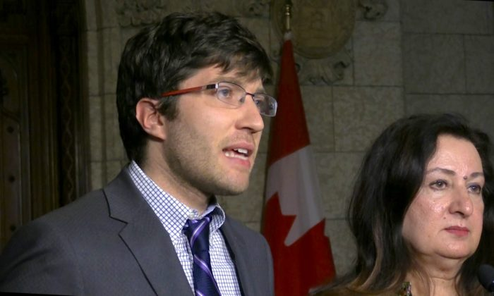 Canadian MP Garnett Genuisand Sen. Salma Ataullahjan speak at a press conference on Oct. 25 in Parliament Hill in Ottawa, two days after the passing of Bill S-240. (Limi Zhou/NTD Television)