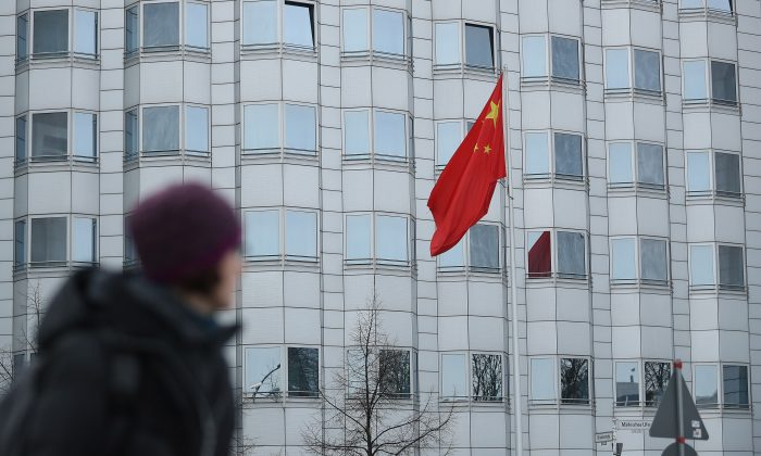 A woman walks past a Chinese Embassy in a file photo. (Sean Gallup/Getty Images)