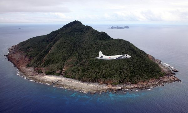 A Japanese patrol plane flying over the disputed islets known as the Senkaku islands in Japan.