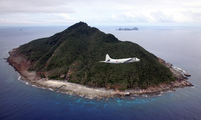 A Japanese patrol plane flying over the disputed islets known as the Senkaku islands in Japan and Diaoyu islands in China, located in the East China Sea on October 13, 2011. Muji has drawn the ire of Beijing over the Senkaku islands issue. (JAPAN POOL/AFP/Getty Images)