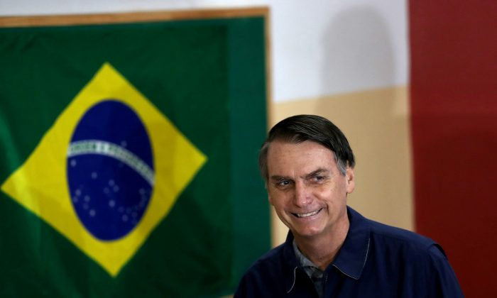 Jair Bolsonaro, lawmaker and presidential candidate of the Social Liberal Party (PSL), arrives to cast his vote in Rio de Janeiro, Brazil, on Oct. 7, 2018. (Ricardo Morales/Reuters)