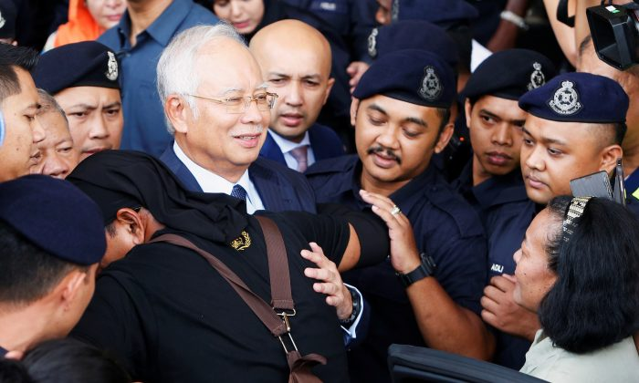 Malaysia's former Prime Minister Najib Razak leaves a court in Kuala Lumpur, Malaysia, on Oct. 4, 2018. (Lai Seng Sin/Reuters)