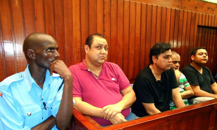 Four suspected top drug traffickers, Baktash Akasha Abdalla (2nd L), Vijaygiri Anandgiri (3rd L), Gulam Hussein (2nd R) and Ibrahim Akasha Abdalla (R) sit on Feb. 9, 2015 in Mombasa Law Courts. (-/AFP/Getty Images)