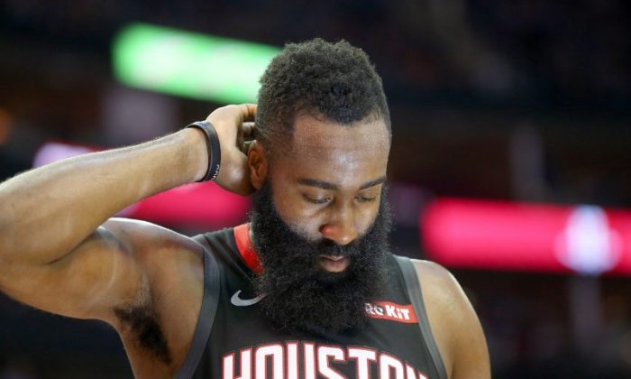 Houston Rockets guard James Harden (13) leaves the court and walks toward the locker room with time left in the fourth quarter at Toyota Center on Oct 24, 2018. (Thomas B. Shea/USA Today Sports)