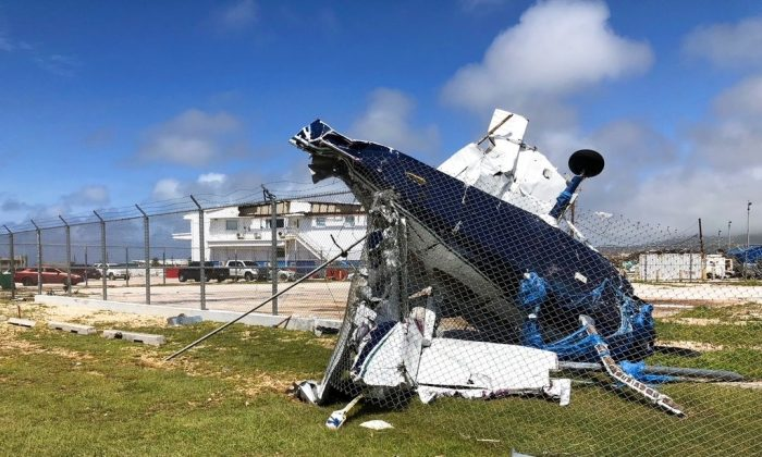 A damaged plane sits at the airport after Super Typhoon Yutu hit the U.S. Commonwealth of the Northern Mariana Islands, Oct. 26, 2018, in Garapan, Saipan. (AP Photo/Dean Sensui)