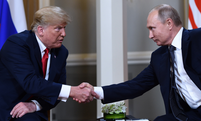 Russian President Vladimir Putin (R) and US President Donald Trump shake hands before a meeting in Helsinki, on July 16, 2018. (Brendan Smialowski/AFP/Getty Images)